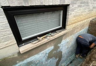 Exterior crack repaired under window